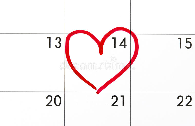 Date of February 14 on the calendar, Valentine's Day red heart encircled stock photos