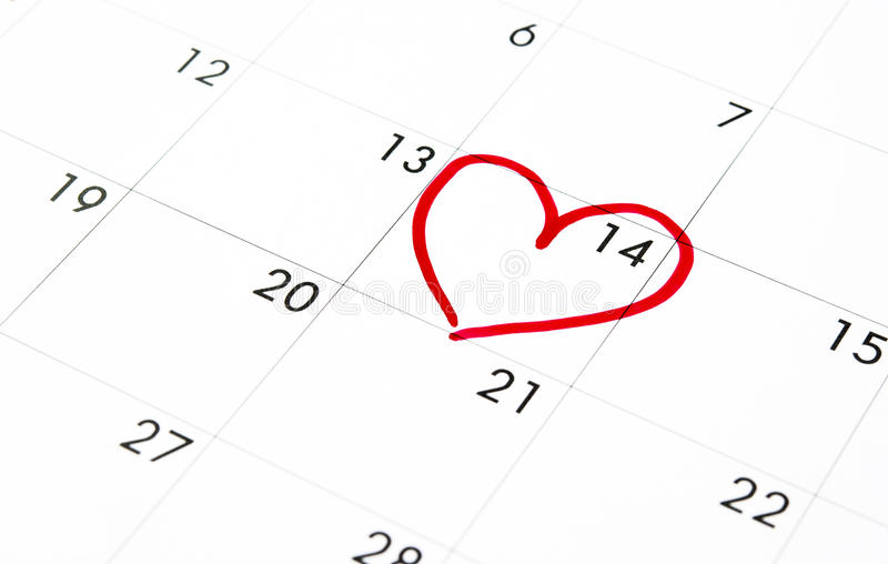 Date of February 14 on the calendar, Valentine's Day red heart encircled stock images