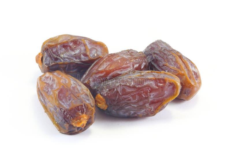 Date fruit. Long dark brown reddish Date fruit stock photo