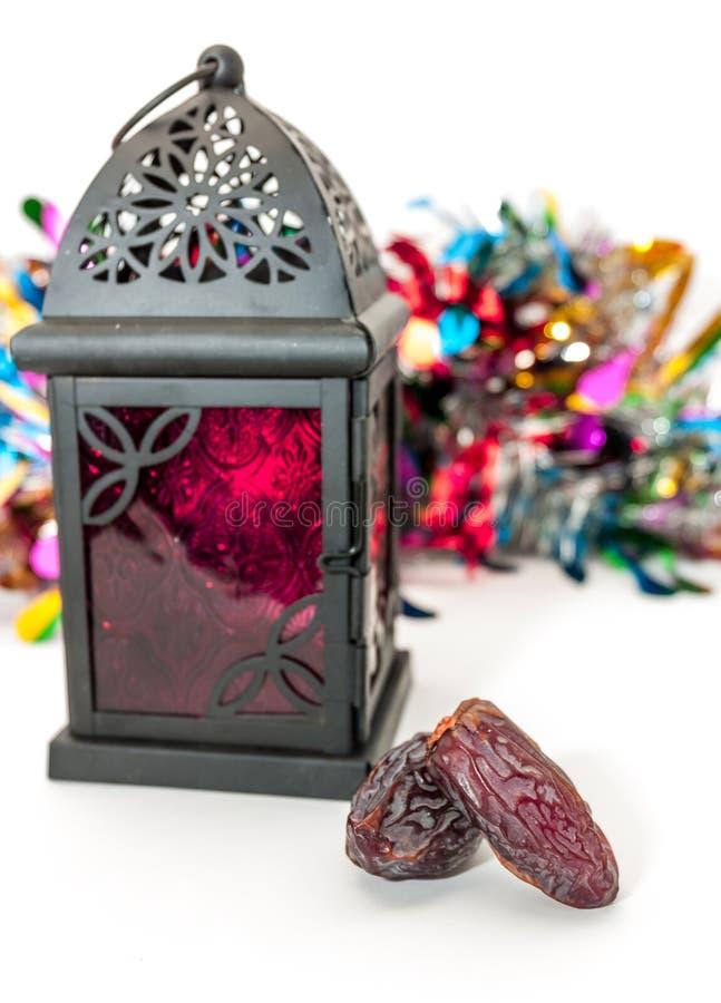 Date fruits and arabic lantern. Ramadan Eid concept stock photos