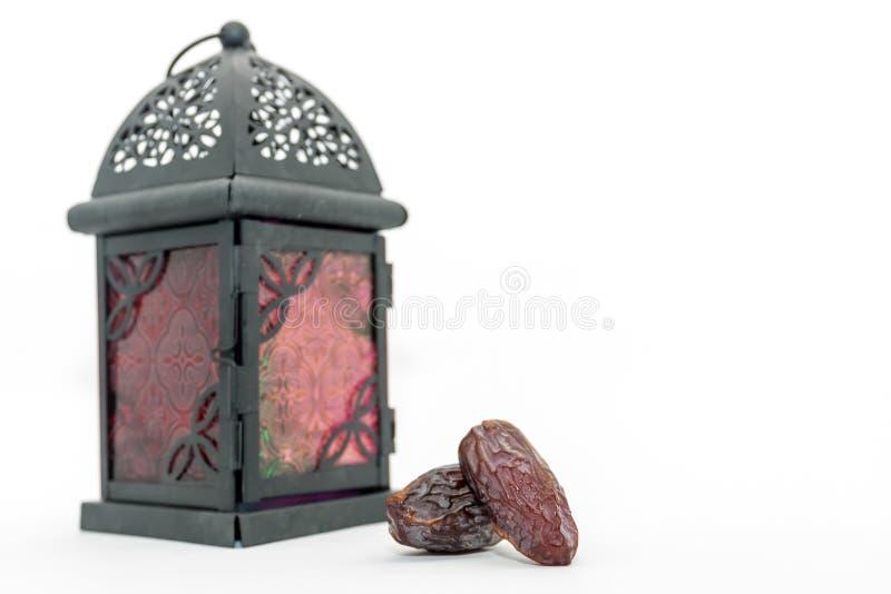 Date fruits and arabic lantern. Ramadan Eid concept stock photography