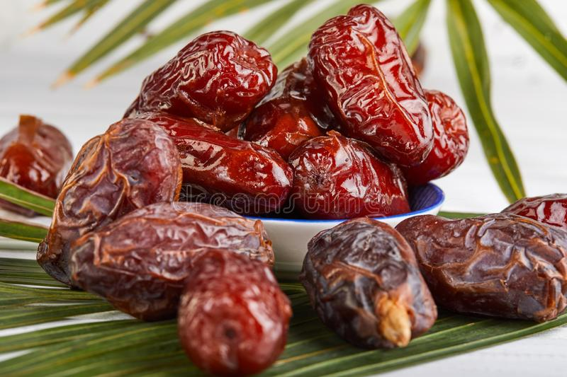 Date fruits with palm leaves, Raw Organic Dates Ready to Eat. Ramadan food concept royalty free stock photography