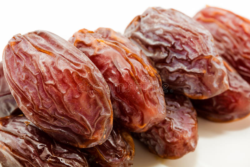 Date fruits in white plate. Ramadan, Eid background concept stock image