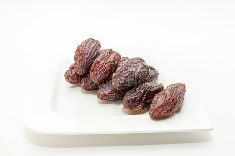 Date fruits in white plate. Ramadan, Eid background concept stock photography