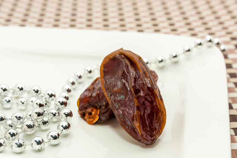 Date fruits in white plate. Ramadan, Eid background concept stock photos