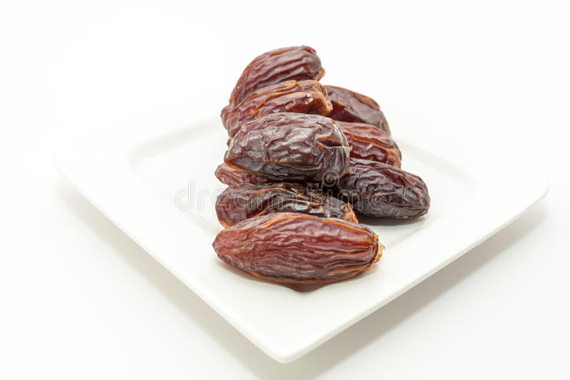 Date fruits in white plate. Ramadan, Eid background concept royalty free stock photo
