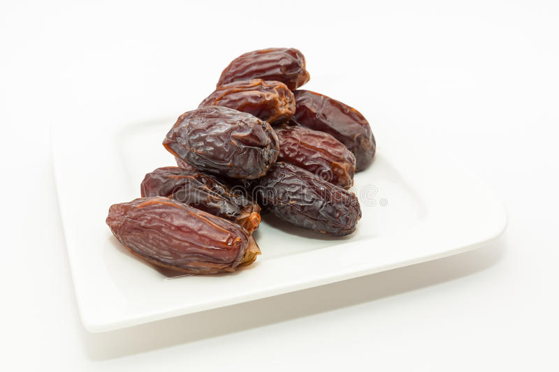 Date fruits in white plate. Ramadan, Eid background concept royalty free stock images