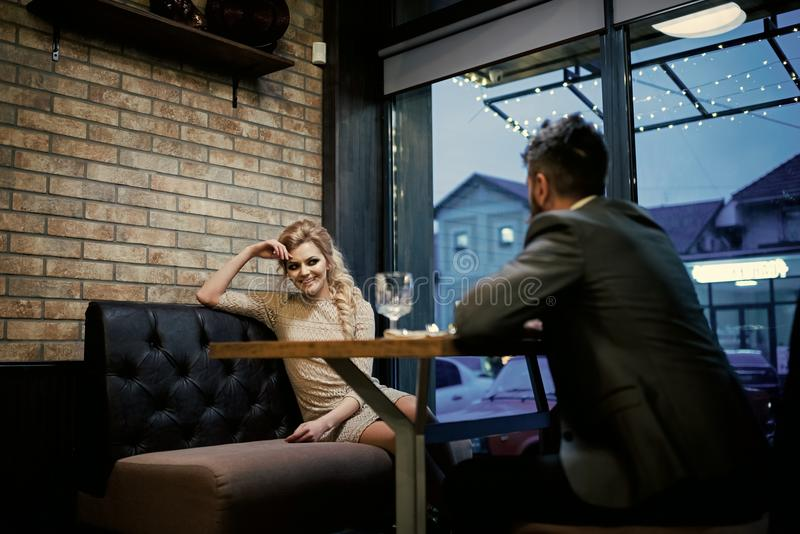 Date a loving couple. Couple in love at the restaurant. Valentines day with woman and bearded man. Proposal and stock images