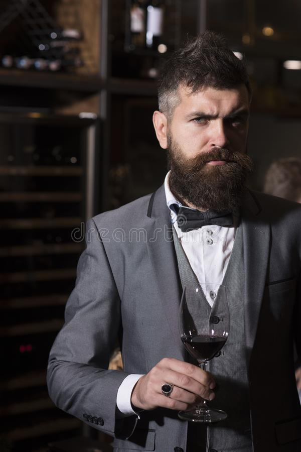 Date meeting of hipster awaiting in pub. bar customer sit in cafe drinking alcohol. Businessman with long beard drink in. Cigar club. Perfect wine. Bearded man royalty free stock images
