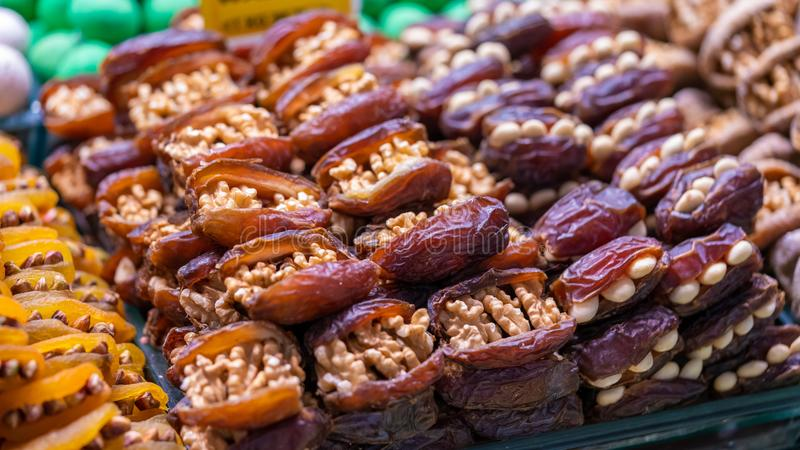 Date Palm Fruit Stuffed With Roasted Nuts. In Turkey Fresh Food Market royalty free stock photography