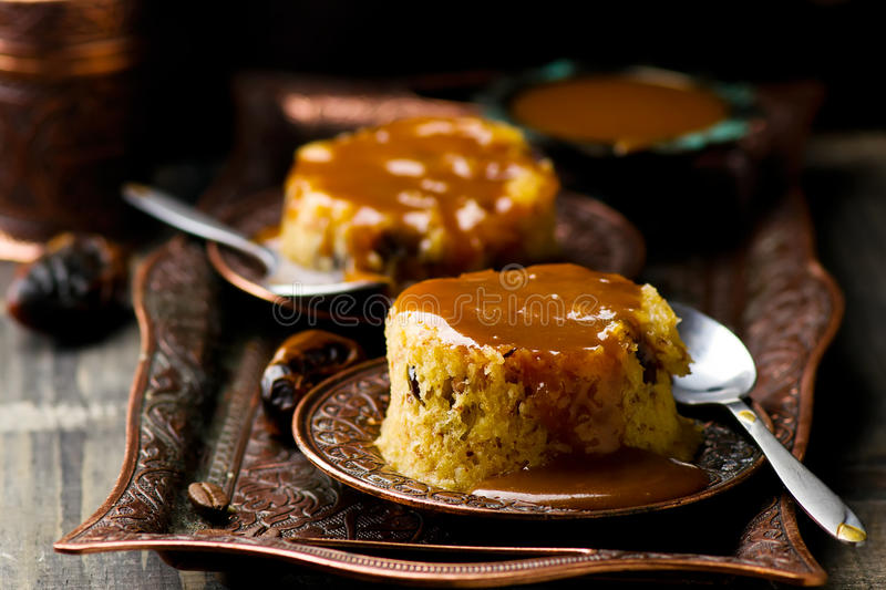 Date pudding with caramel. Selective focus royalty free stock images