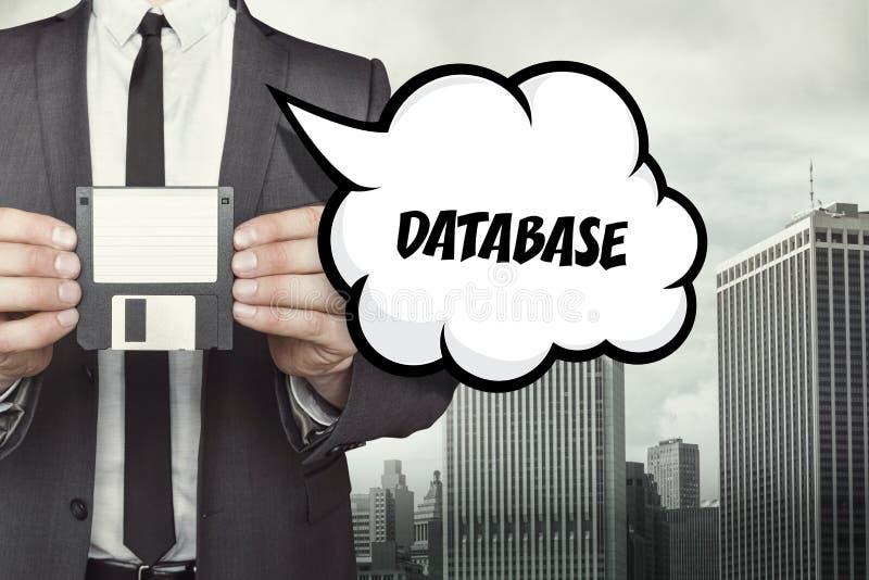 Datenbanktext auf Spracheblase mit Geschäftsmann stockbilder