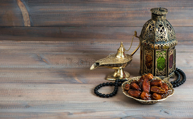 Dates, arabian lantern and rosary. Islamic holiday stock image