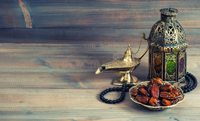 Dates, arabian lantern and rosary. Islamic holiday stock image