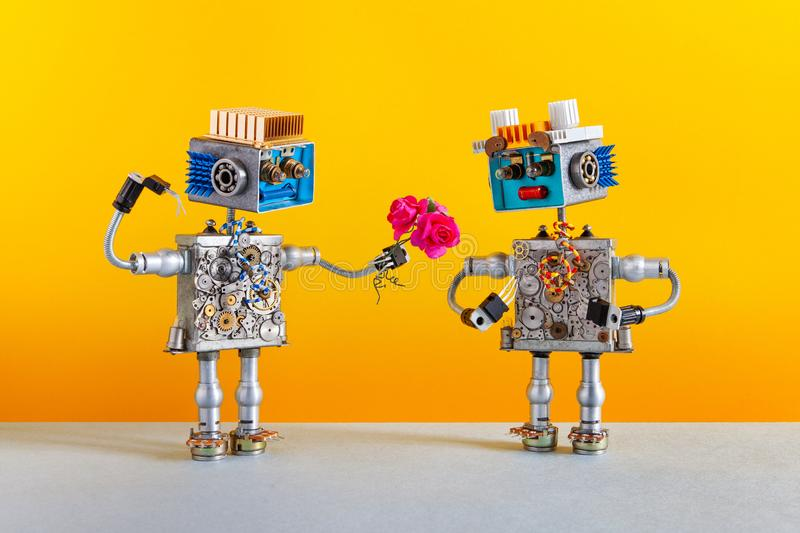 Dates robots. Romantic robot man gives a bouquet of pink roses flowers to a female robot. Dating agency or valentines stock images