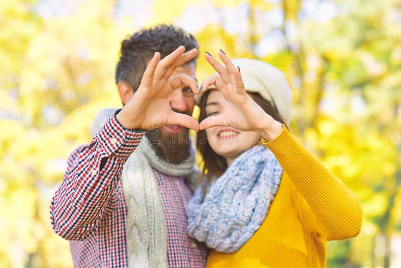 Dating and autumn love concept. Girl and bearded guy stock image