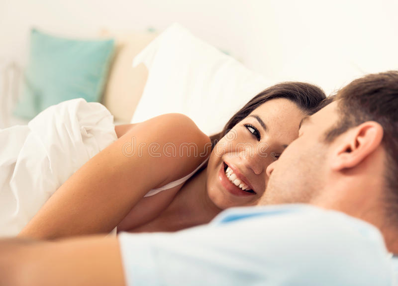 Dating on bed stock image