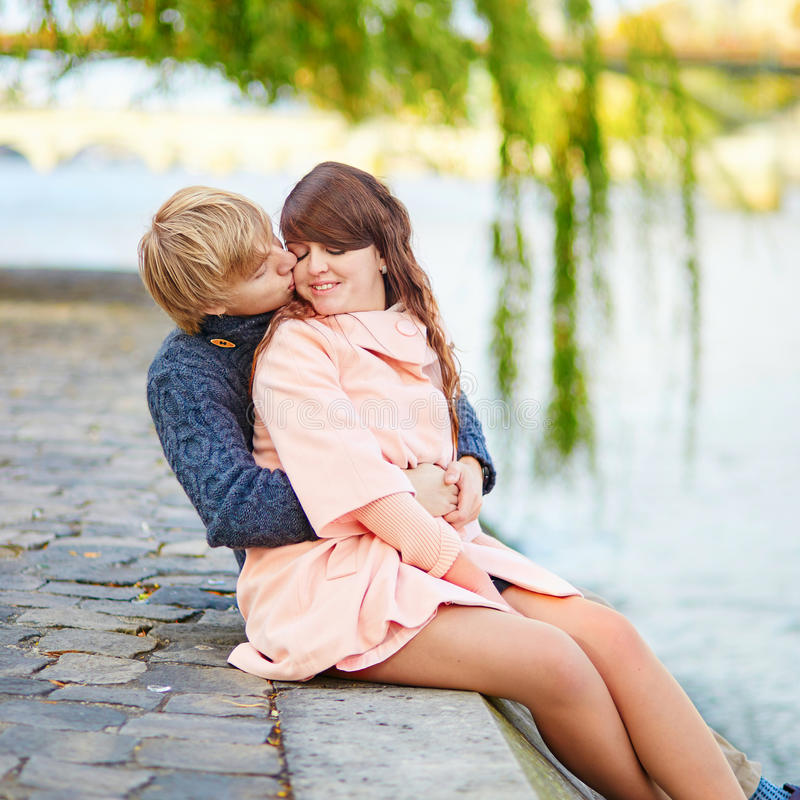Dating couple in Paris on a nice spring day. Young dating couple in Paris near the Seine on a nice spring day royalty free stock image