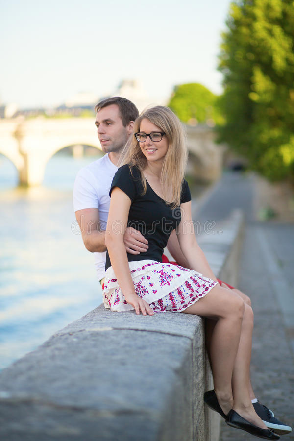 Dating couple on the Seine embankment. In Paris stock photos