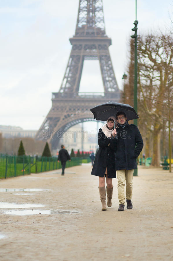 Dating couple under the rain. In Paris royalty free stock images