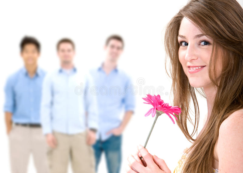 The Dating Game. A beautiful woman holding a flower