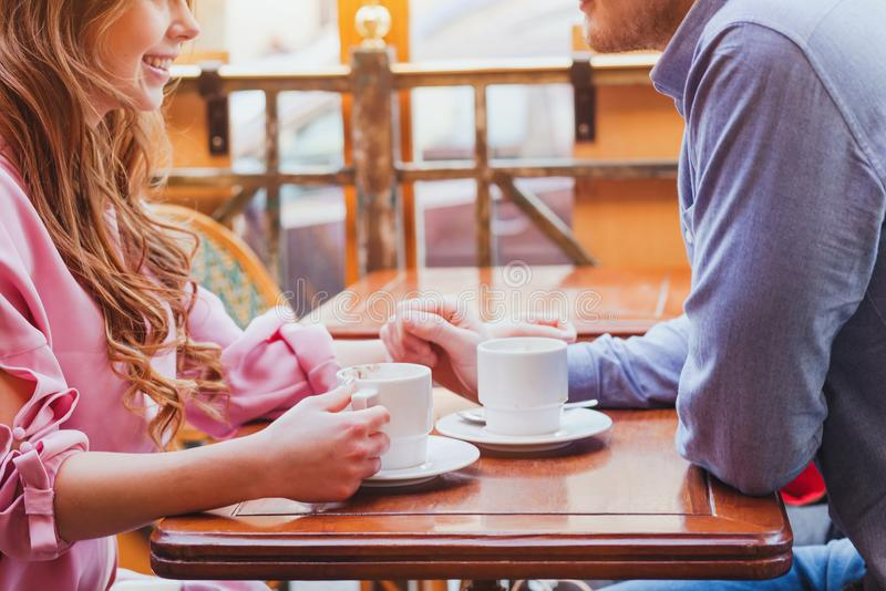 Dating, hands of couple in cozy cafe royalty free stock photo