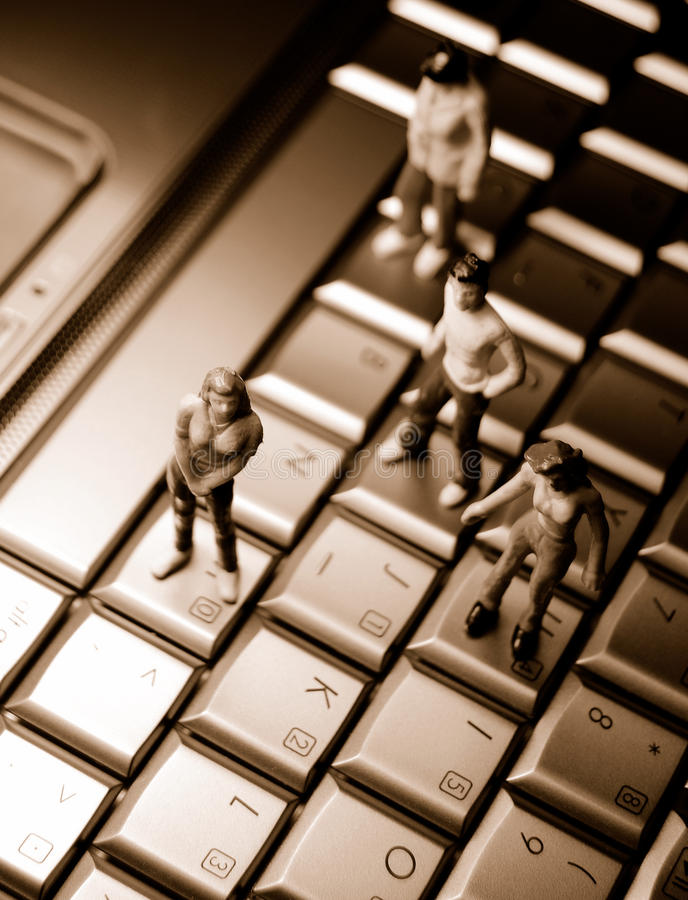 Dating Online. Miniature people on laptop keyboard suggesting online dating stock photo