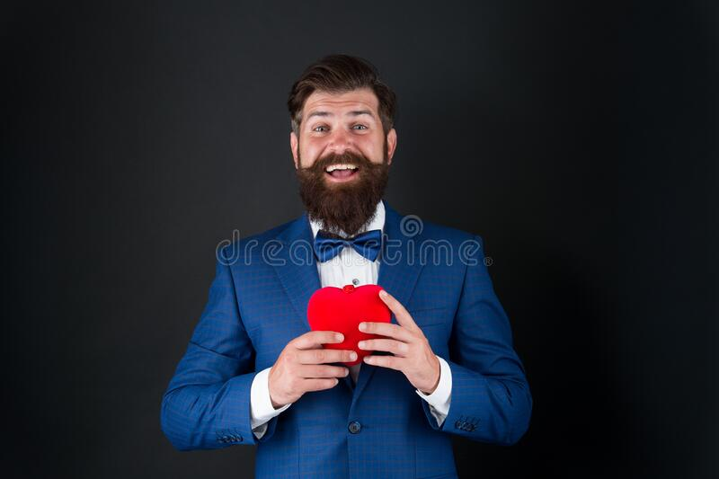 Dating services. Gentleman concept. True gentleman. Valentines day. Well groomed handsome bearded man wear tuxedo royalty free stock images