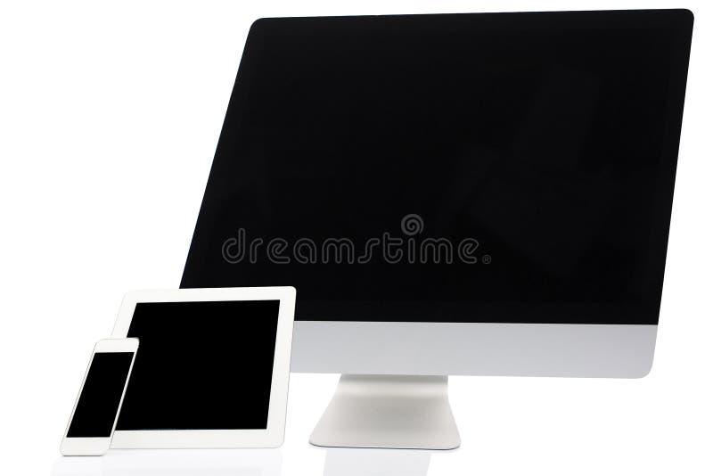 Dator, minnestavla och Smartphone på vit royaltyfria foton