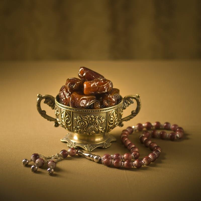 Dattes cuvette et rosaire images libres de droits