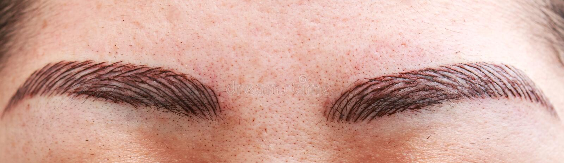Dauerhafte Augenbrauentätowierung stockbild