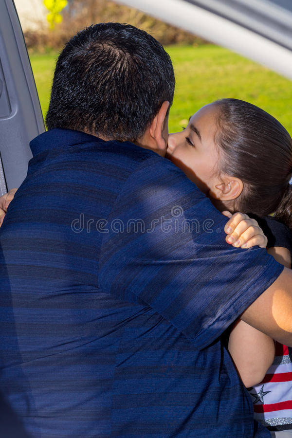 Daughter Affectionately Greets Father royalty free stock photo
