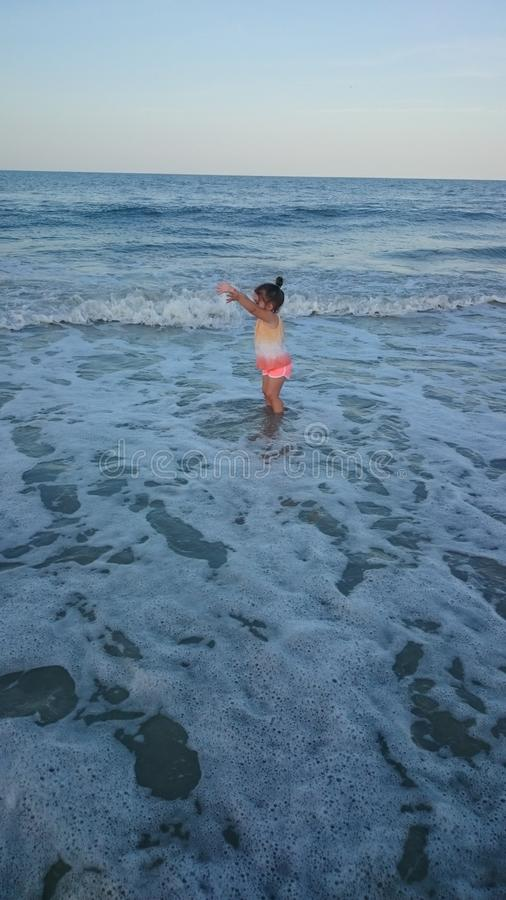 Daughter at the beach royalty free stock images