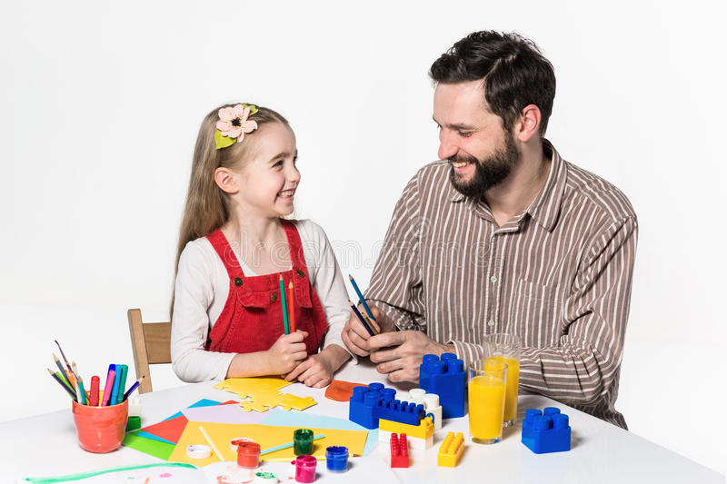 The daughter and father carving out paper applications. Together on white background royalty free stock photography