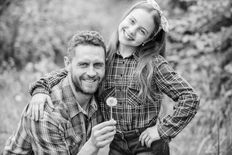 Daughter and father with dandelion. spring village country. ecology. Happy family day. little girl and happy man dad stock images