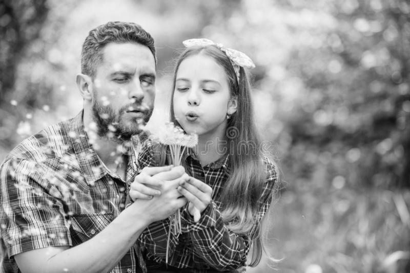 Daughter and father love dandelion flower. family summer farm. spring village country. little girl and happy man dad royalty free stock image