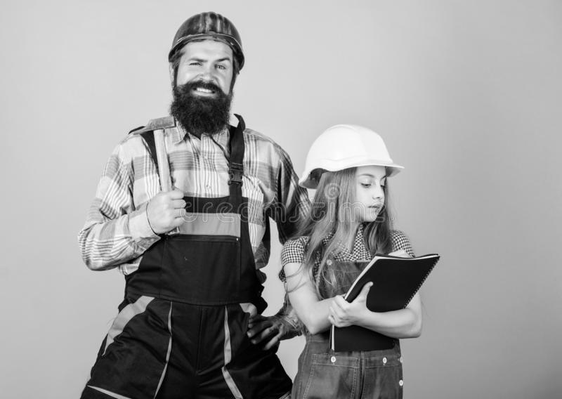 Daughter and father repairing in workshop. Bearded man with little girl. engineering education. construction worker royalty free stock images