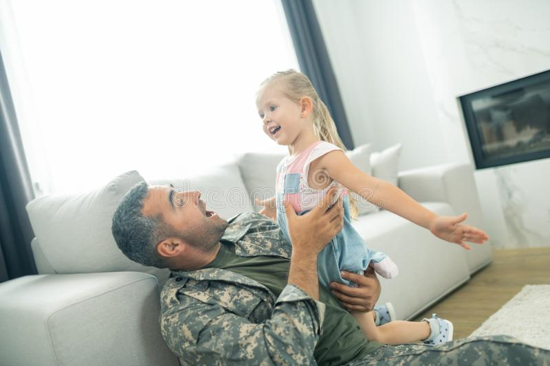 Daughter feeling involved while spending time with daddy stock images