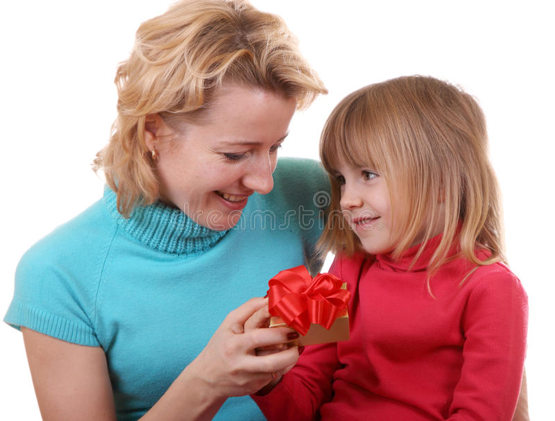 Daughter gives a gift to mum stock image