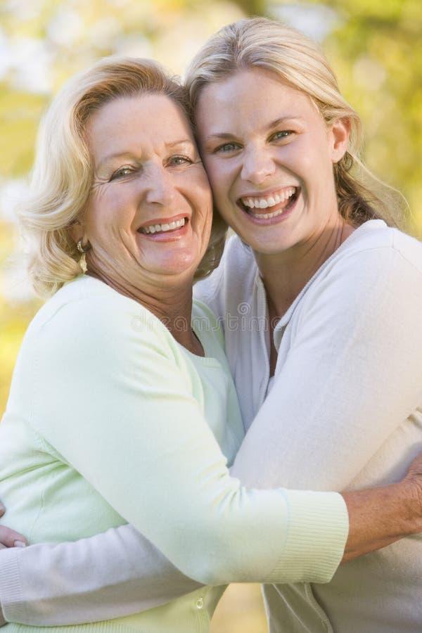 daughter grown hugging mother up