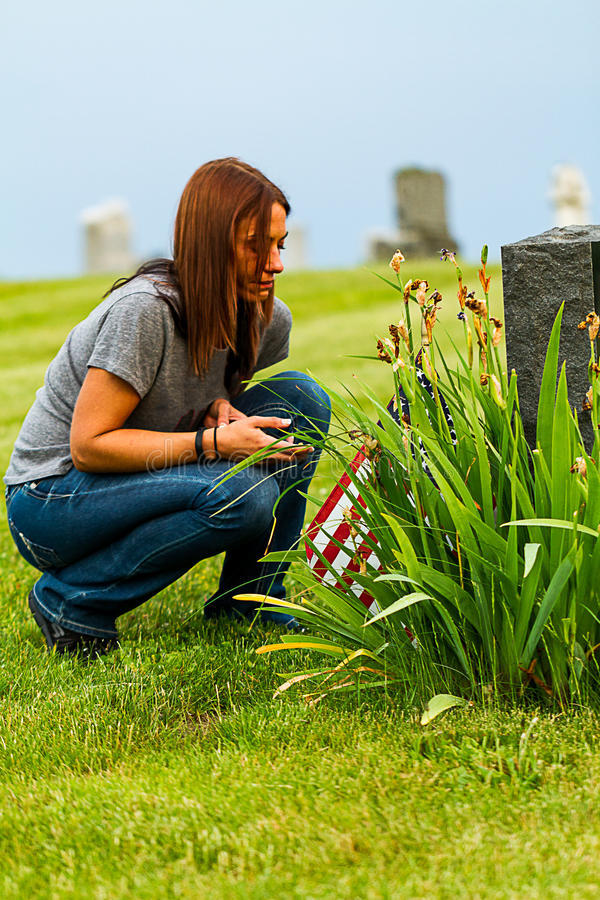 A Daughter at her Fathers Grave Site stock images