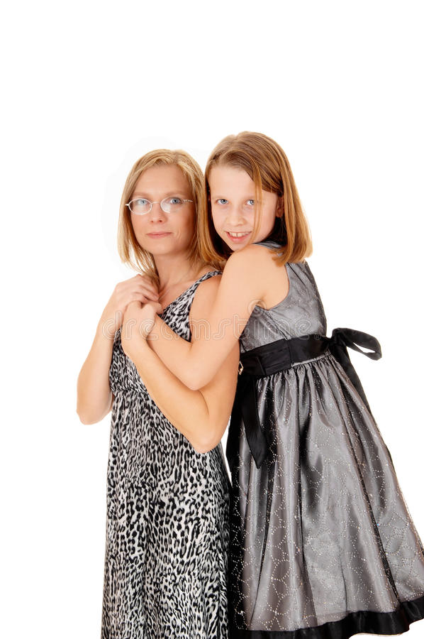 Daughter hugging mom. Mother and daughter standing isolated for white background, the daughter hugging her mom royalty free stock photos