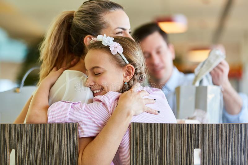 Daughter hugging mother while shopping royalty free stock photo