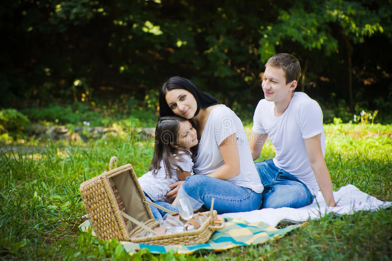 Daughter hugs with mother. Picnic royalty free stock photo