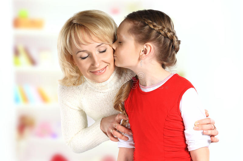 Download Daughter kiss her mother stock photo. Image of people - 36145282