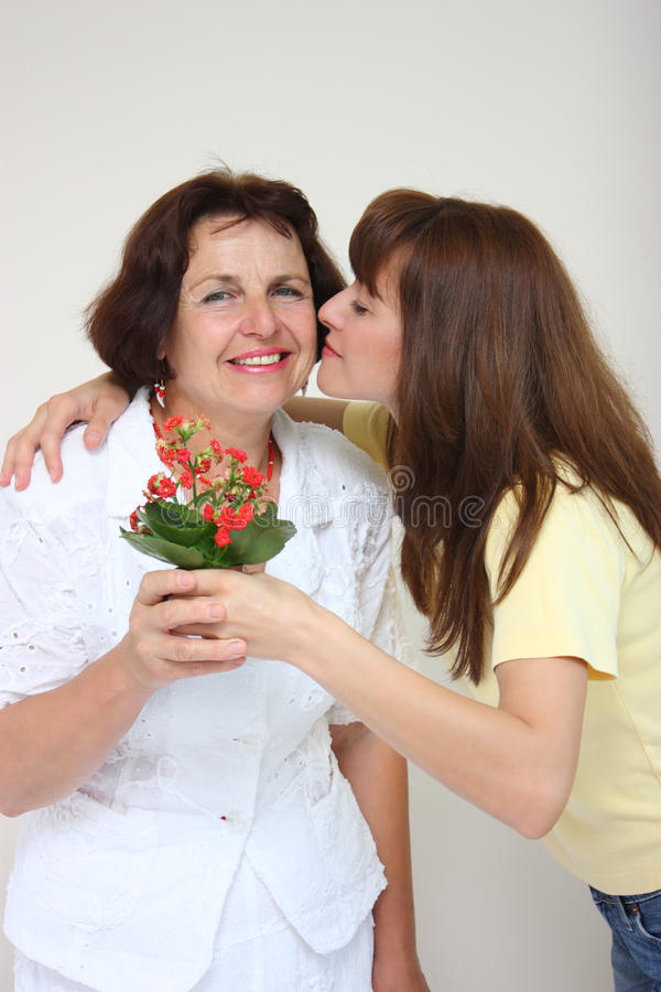 A daughter kissing her mother royalty free stock images