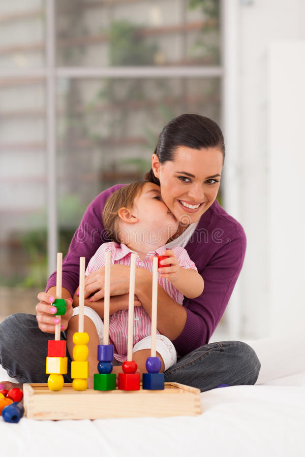 Daughter Kissing Mother Royalty Free Stock Photos