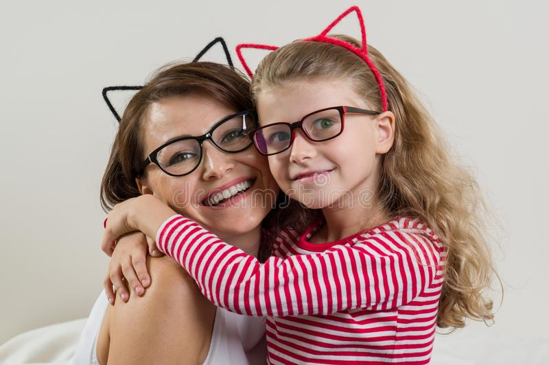 The daughter lovingly embraces her mother. Parent and child in g royalty free stock photo