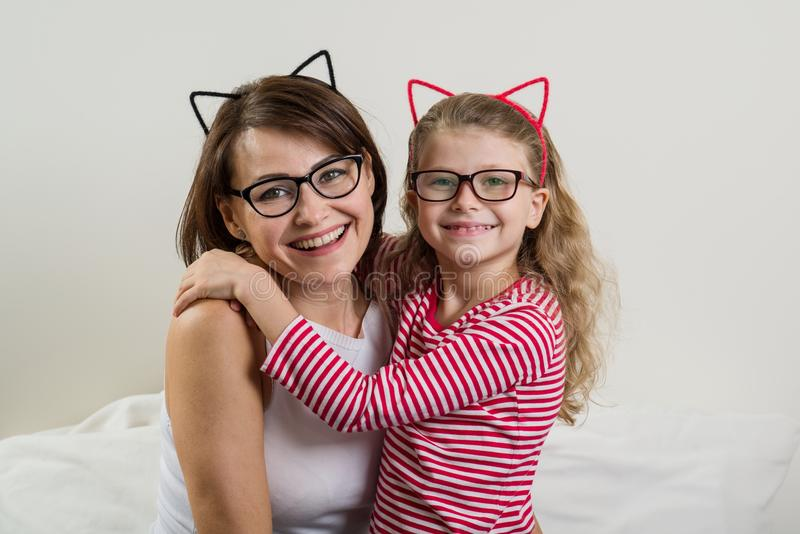 The daughter lovingly embraces her mother. Parent and child in g royalty free stock photography