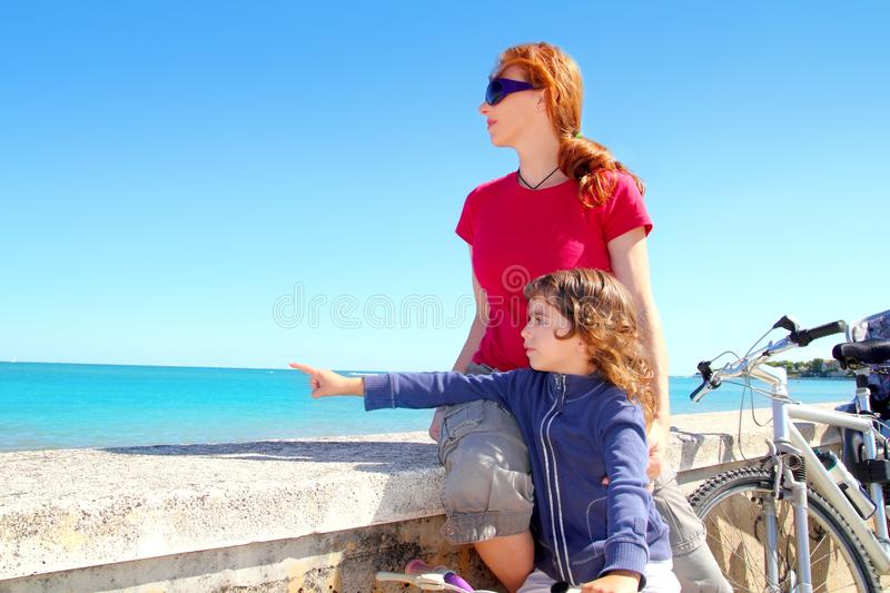 Download Daughter And Mother On Bicycle In Beach Stock Photo - Image: 19401158